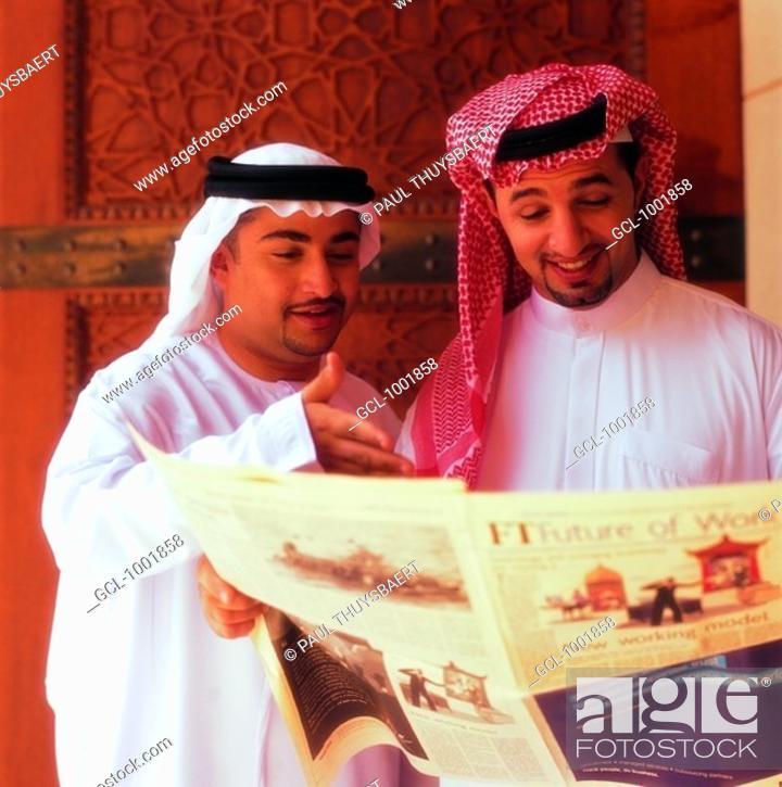 Stock Photo: Arab men reading newspaper.