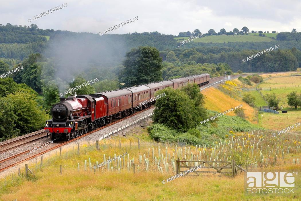 Stock Photo: Steam locomotive LMS Jubilee Class 45699 Galatea on the Settle to Carlisle Railway Line near Lazonby, Eden Valley, Cumbria, England, UK.