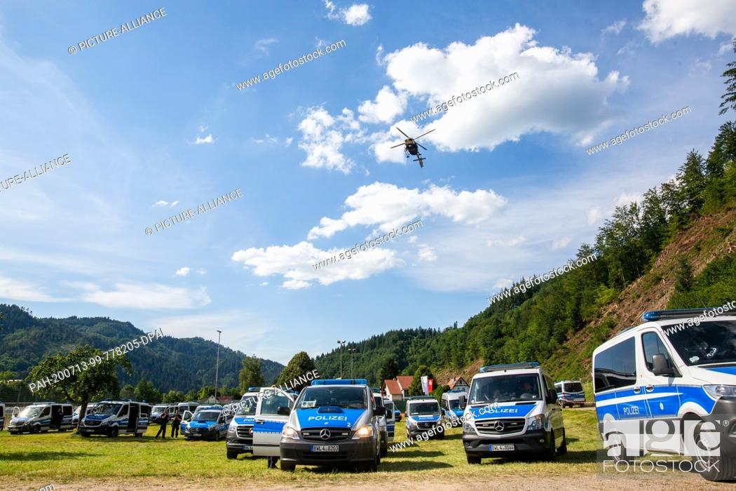 Stock Photo: dpatop - 13 July 2020, Baden-Wuerttemberg, Oppenau: A police helicopter flies over a sports field near the community of Oppenau.