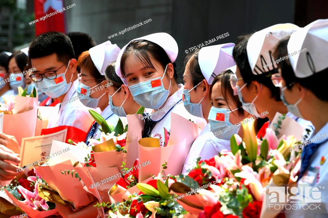 Stock Photo: May 12, 2020, Fuzhou, Fujian, China: The nurses were collective cited for their distinguished service in Hubei on the International Nurses Day in Fuzhou, Fujian.