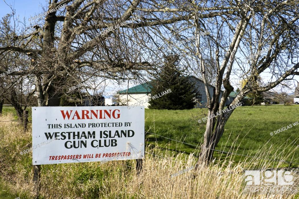 Stock Photo: Warning sign on Westham Island, Ladner, British Columbia, Canada.