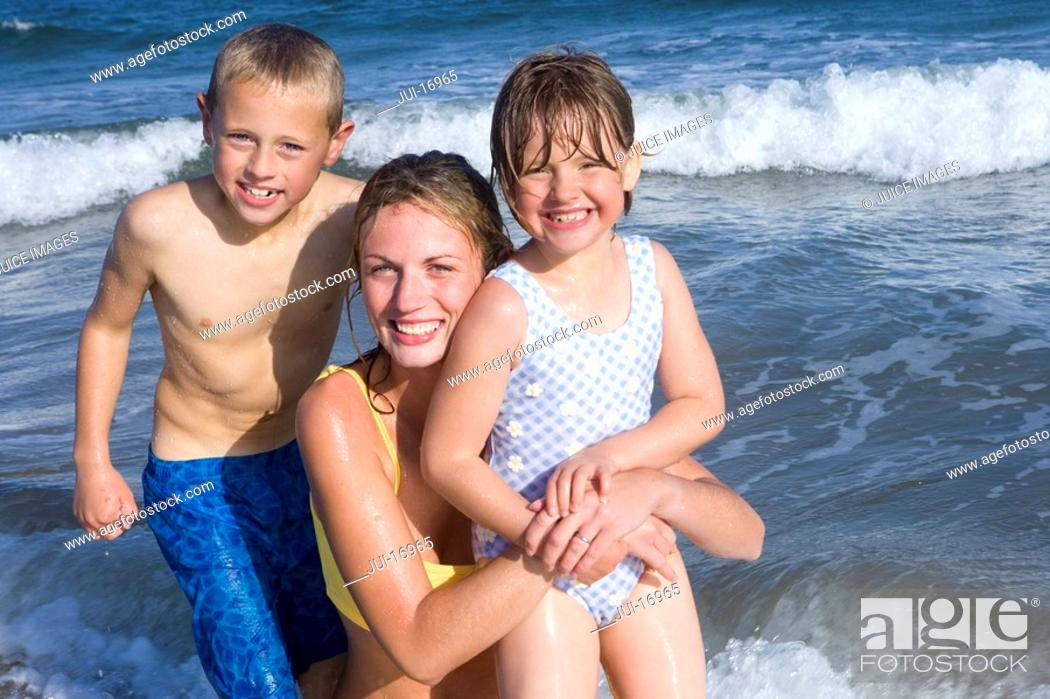 Stock Photo: Portrait of mother with children in sea.