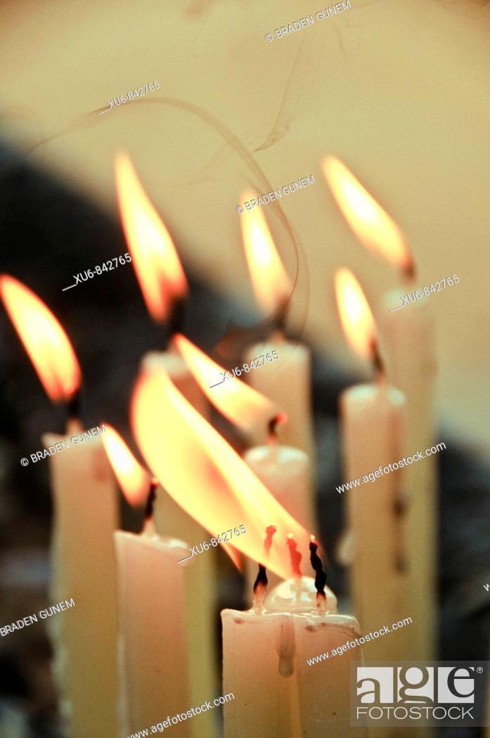 Stock Photo: Candles burning at a Christian shrine Vypeen Island, Kerala, India.