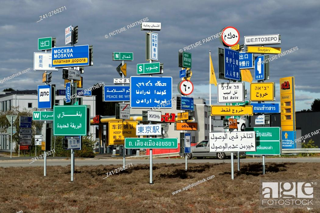 Stock Photo: Signs in different languages on a traffic square in Almhult, Sweden, Scandinavia.