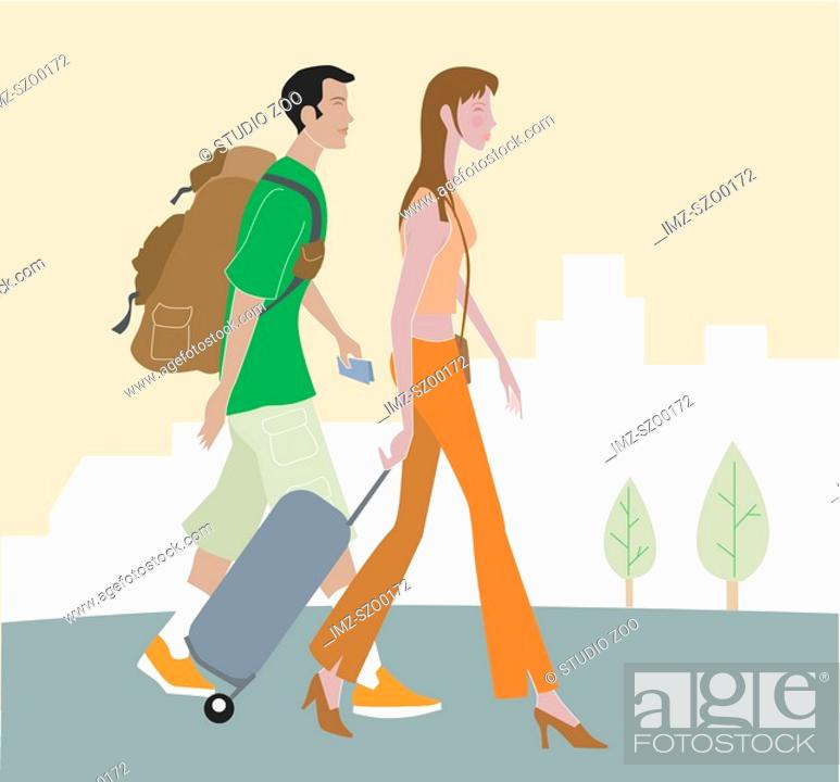 Stock Photo: Man and woman walking with luggage.
