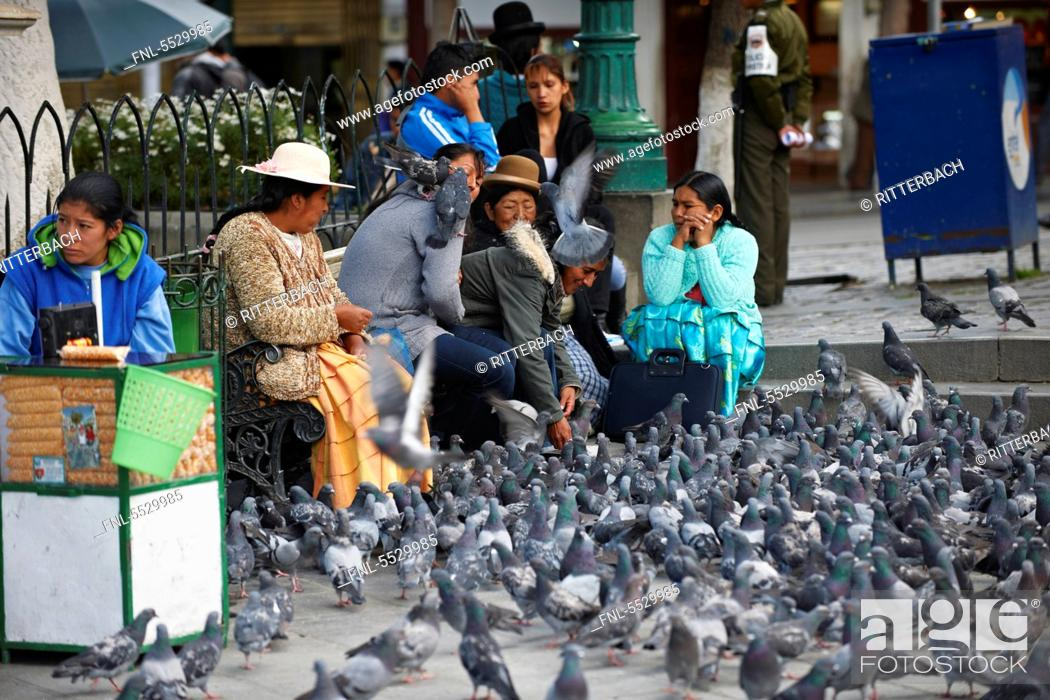 Stock Photo: Locals with pigeons on the Plaza Murillo, La Paz, Bolivia.