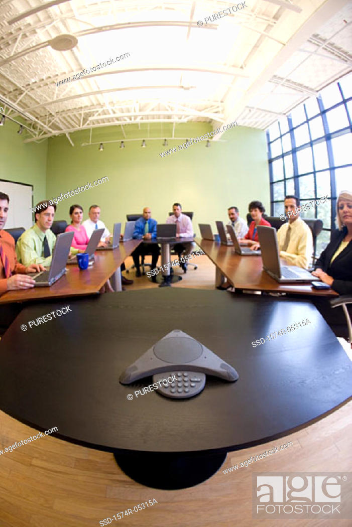 Stock Photo: Portrait of a group of business executives sitting in a conference room.