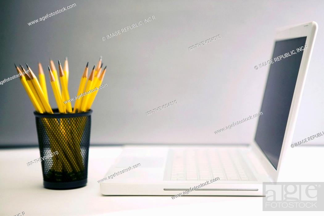 Stock Photo: pencils and laptop.