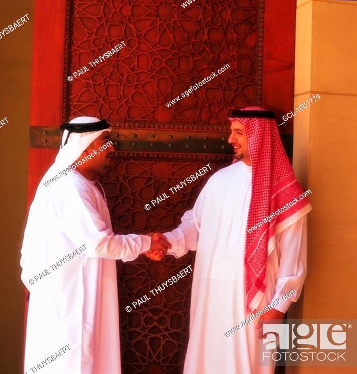 Stock Photo: Arab men shaking hands.