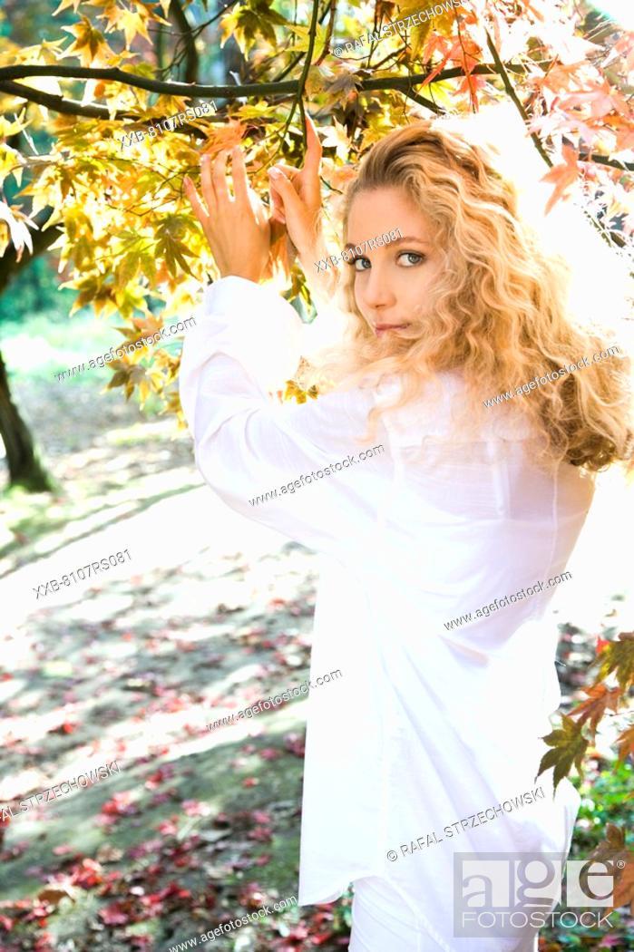 Stock Photo: Blond woman in autumn park.