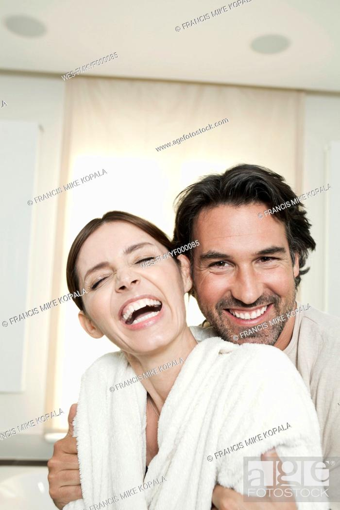Stock Photo: Germany, Berlin, Mature couple in bathroom, smiling.