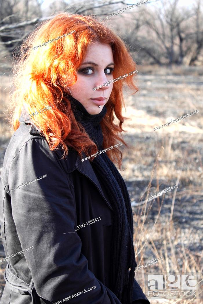 Stock Photo: red haired girl outdoors torso.