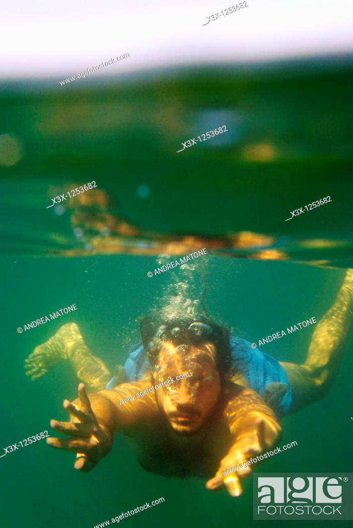 Stock Photo: A man swimming underwater in the Mediterranean sea Italy.