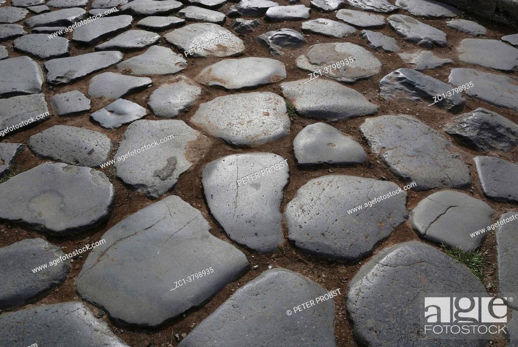 Stock Photo: Ancient cobblestones at the Colosseum in Rome - Italy.