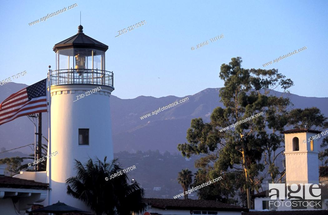 Stock Photo: Santa Barbara lighthouse and the USA flag at sunset.