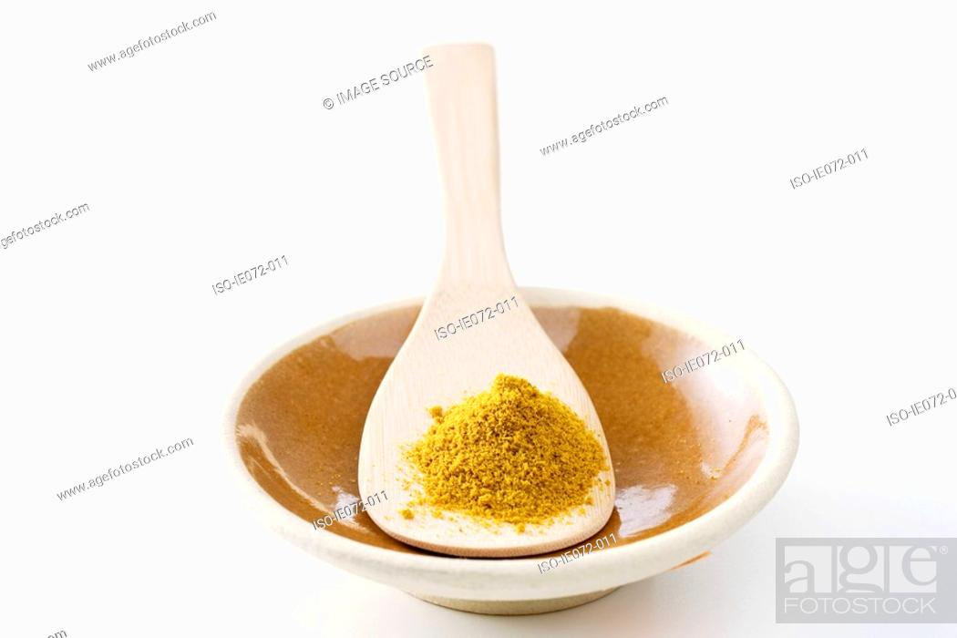 Stock Photo: Curry powder wooden spoon and bowl.