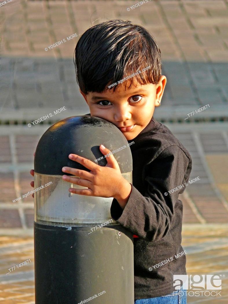 Stock Photo: 3 yeard old girl on playground near a Lamppost, Pune, Maharashtra, India.