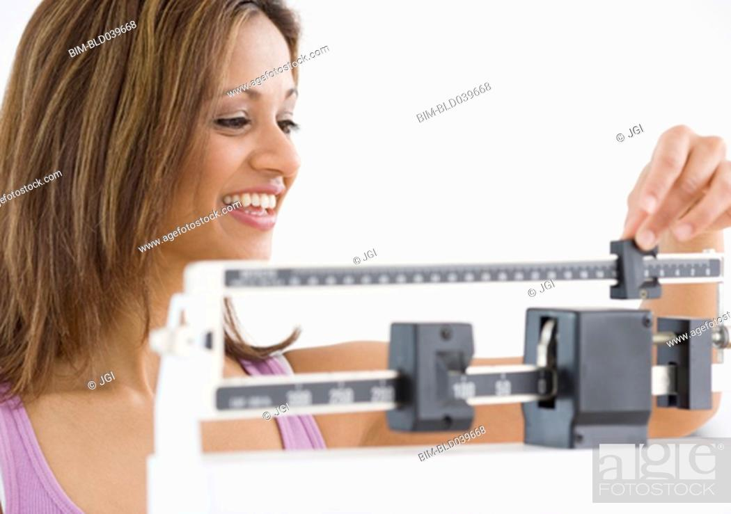 Stock Photo: Indian woman on scale.