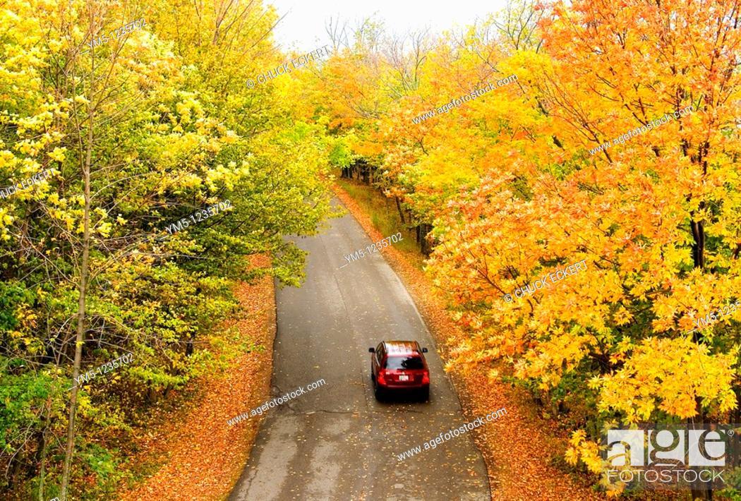 Stock Photo: Car driving through Peninsula State Park, Door County, Wisconsin, USA during the autumn peak season,.