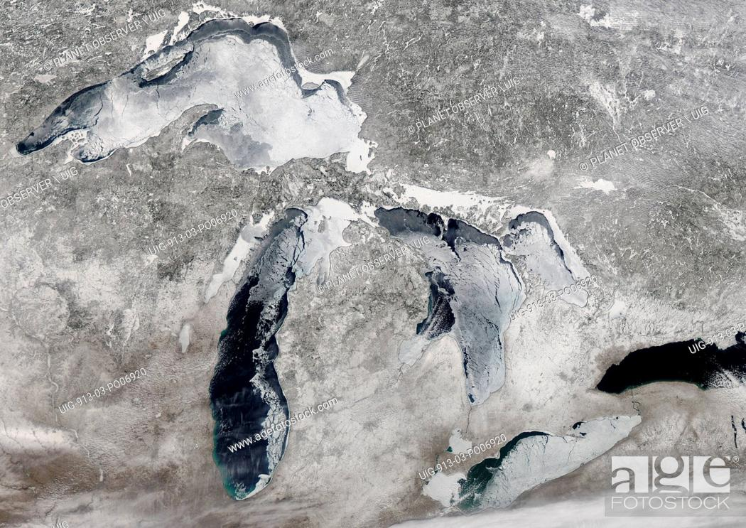 Stock Photo: Satellite view of the Great Lakes region covered with ice and snow. This image was taken on March 16, 2014 by Landsat 8 satellite.