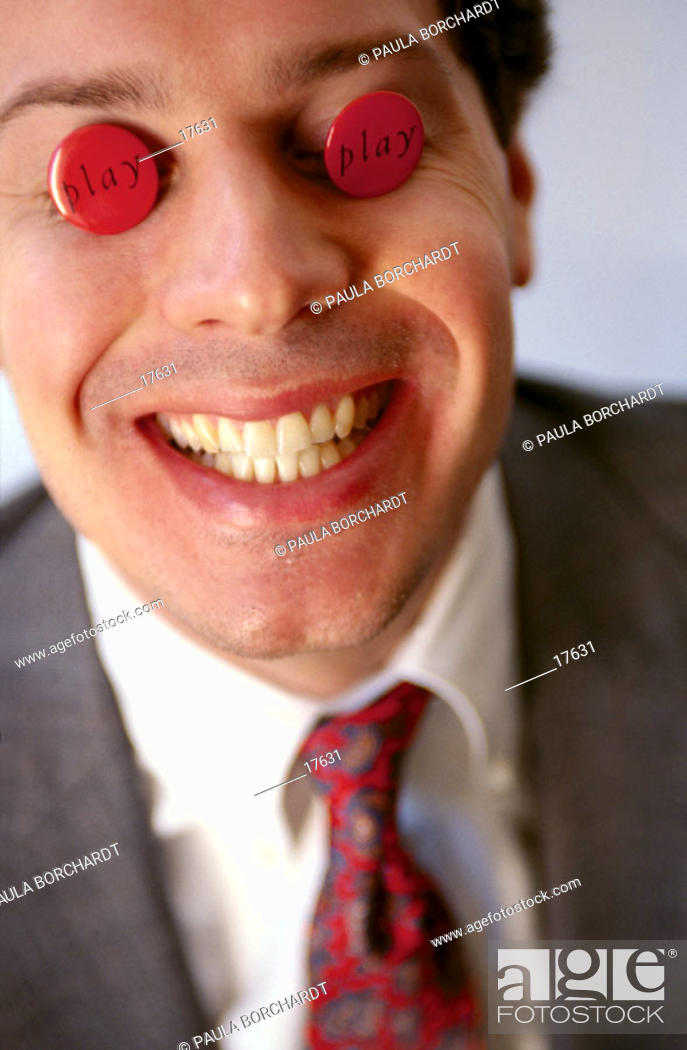 Stock Photo: Businessman with 'play' buttons over his eyes.