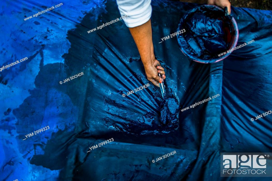 Stock Photo: A Salvadoran farm worker collects indigo paste processed at the semi-industrial manufacture near San Miguel, El Salvador, 12 November 2016.