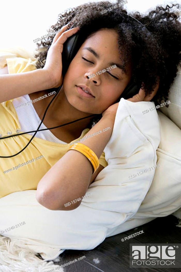 Stock Photo: Close-up of a girl listening to music.