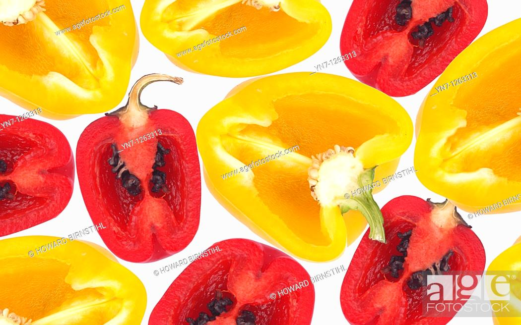 Stock Photo: Still life product image of red and yellow chillie halves.