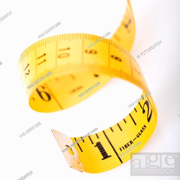 Stock Photo: Curly measuring tape.