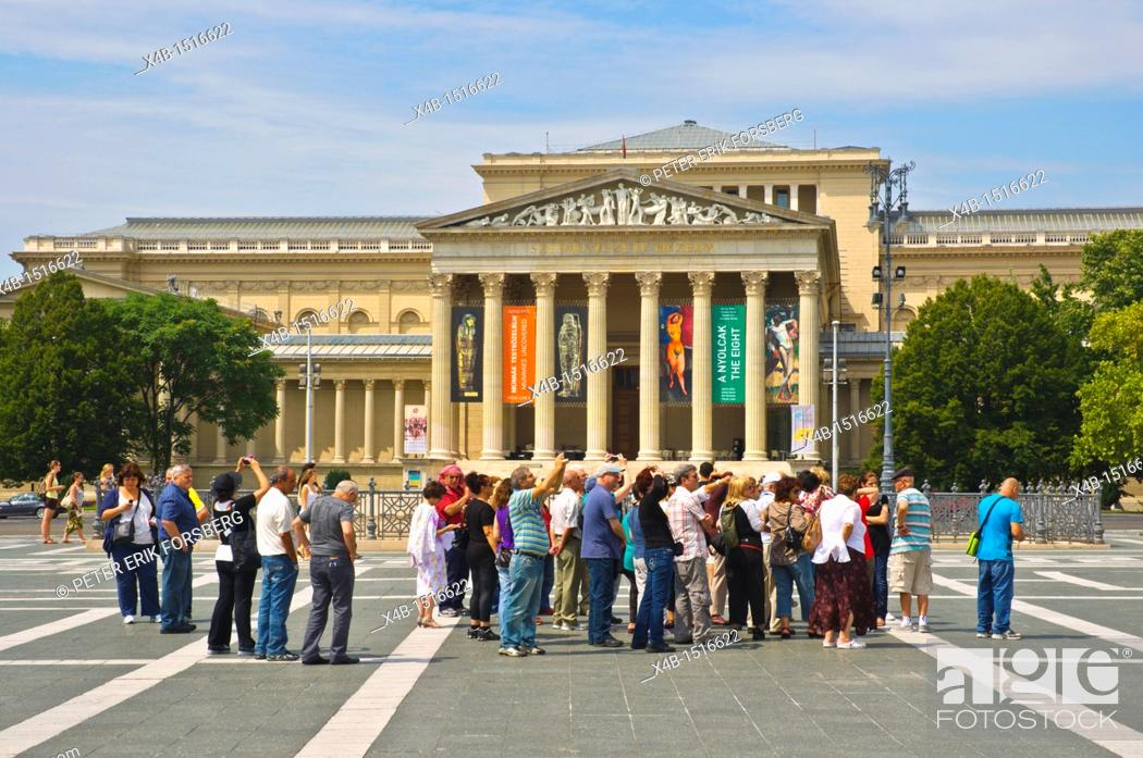 Stock Photo: Tourist group Hösök Tere the Heroes' Square with Museum of Fine Arts in background Budapest Hungary Europe.