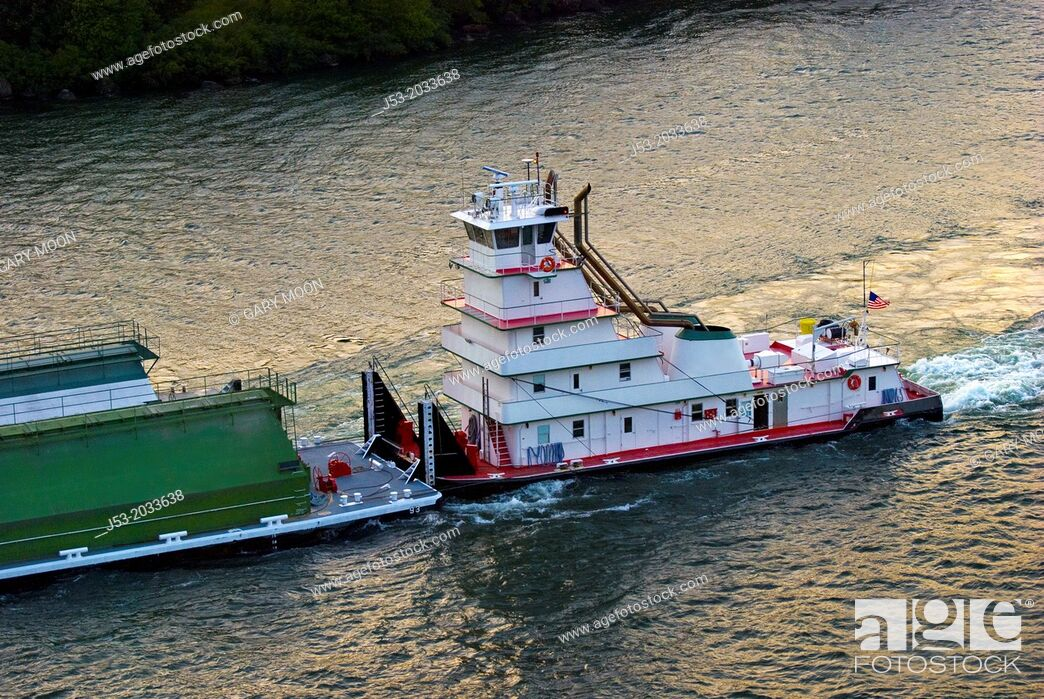 Stock Photo: Barges and tugboat on Columbia River, heading west, Columbia River Gorge, from historic Bridge of the Gods between Oregon and Washington, USA.