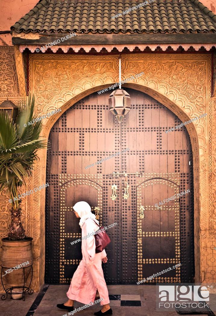 Stock Photo: Moroccan girl walking, Marrakech, Morocco.