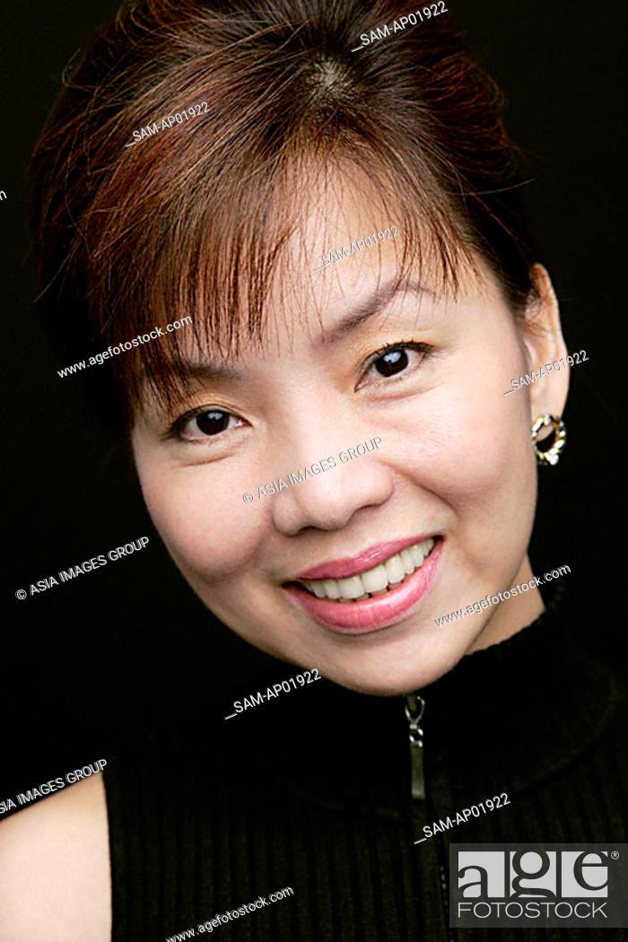 Stock Photo: Woman smiling at camera, head shot.