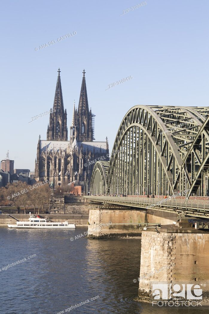 Stock Photo: The Hohenzollern Bridge (German: Hohenzollernbrücke) is a bridge crossing the river Rhine in the German city of Cologne . Germany.