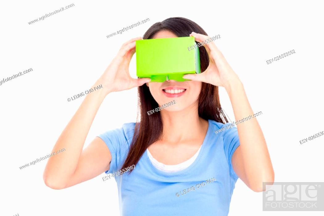 Stock Photo: Woman cardboard virtual reality goggle.