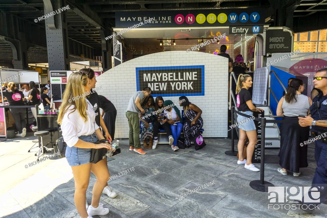 Stock Photo: Visitors celebrate National Lipstick Day at a Maybelline pop-up branding event in Hudson Yards in New York on Monday, July 29, 2019.