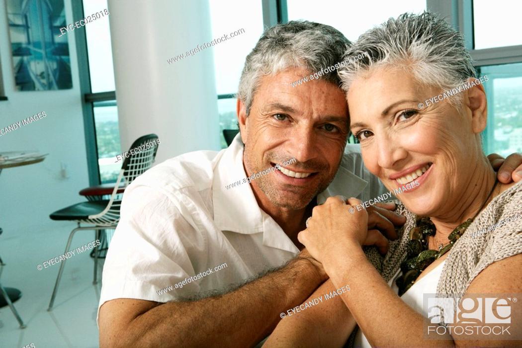 Stock Photo: Mature couple looking at camera smiling.