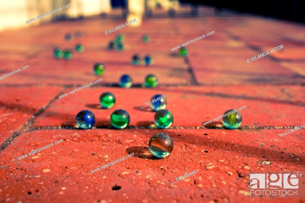 Stock Photo: Group of marbles on the floor.