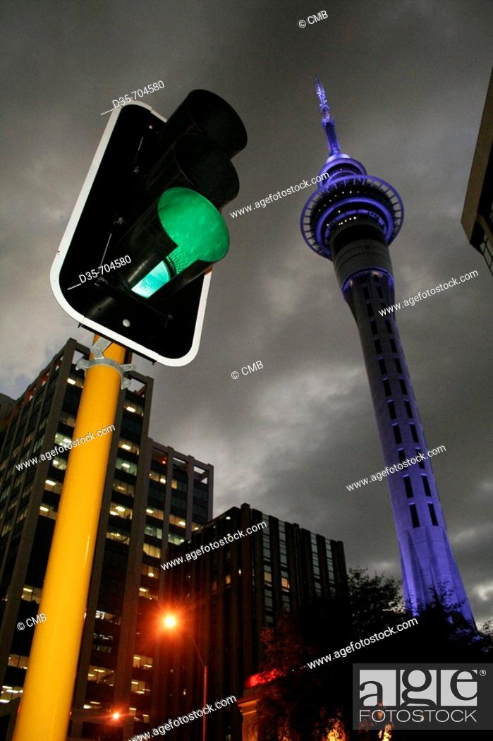 Stock Photo: Traffic light and Skytower and dark sky in Auckland City, Auckland, North Island, New Zealand.