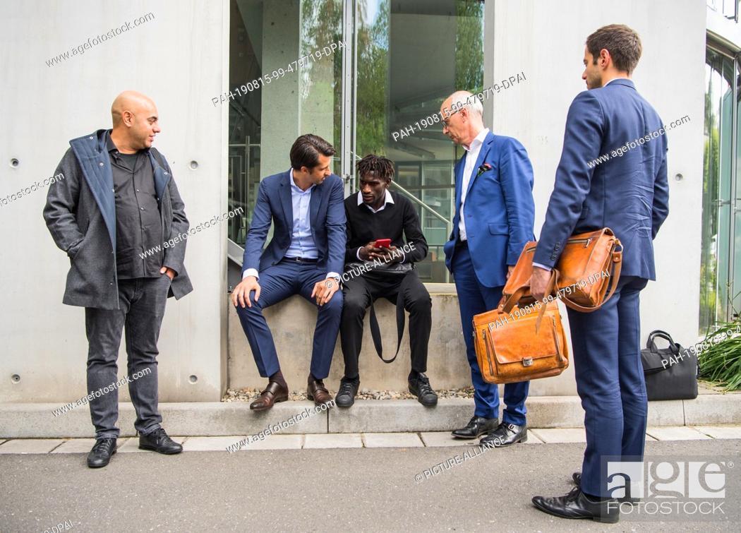 Stock Photo: 15 August 2019, Hessen, Frankfurt/Main: Efe Aktas (l-r), Jatta player advisor, and Jonas Boldt, HSV sports board member, are on the DFB grounds with Bakery.