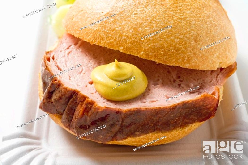 Stock Photo: Leberkäse a type of meatloaf in a bread roll.