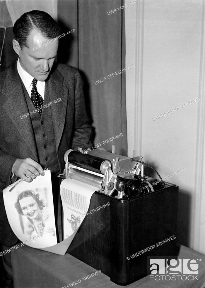 Stock Photo: United States: February 17, 1938.Charles Young, RCA Victor research engineer, has developed a simplified radio facsimile receiver and printer for home use.