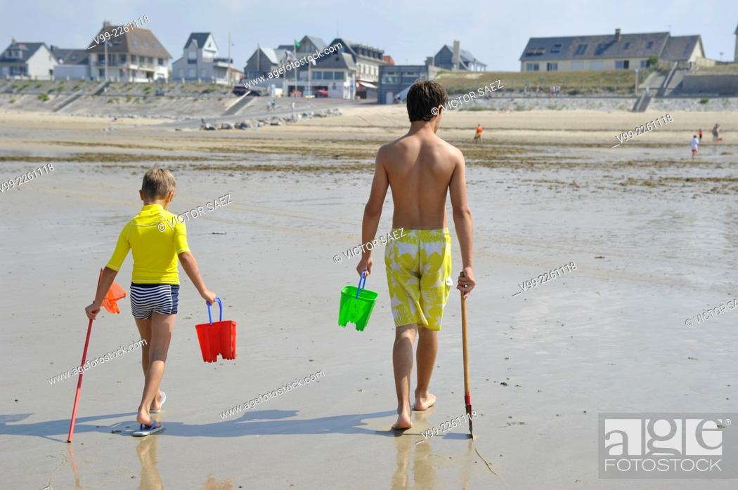 Stock Photo: France, Normandy, Man and boy on beach.