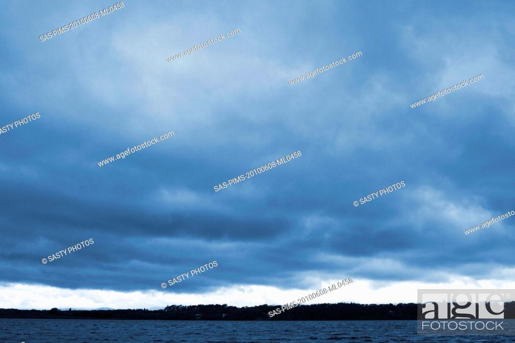 Imagen: Clouds over a lake, Lakes of Killarney, County Kerry, Republic of Ireland.
