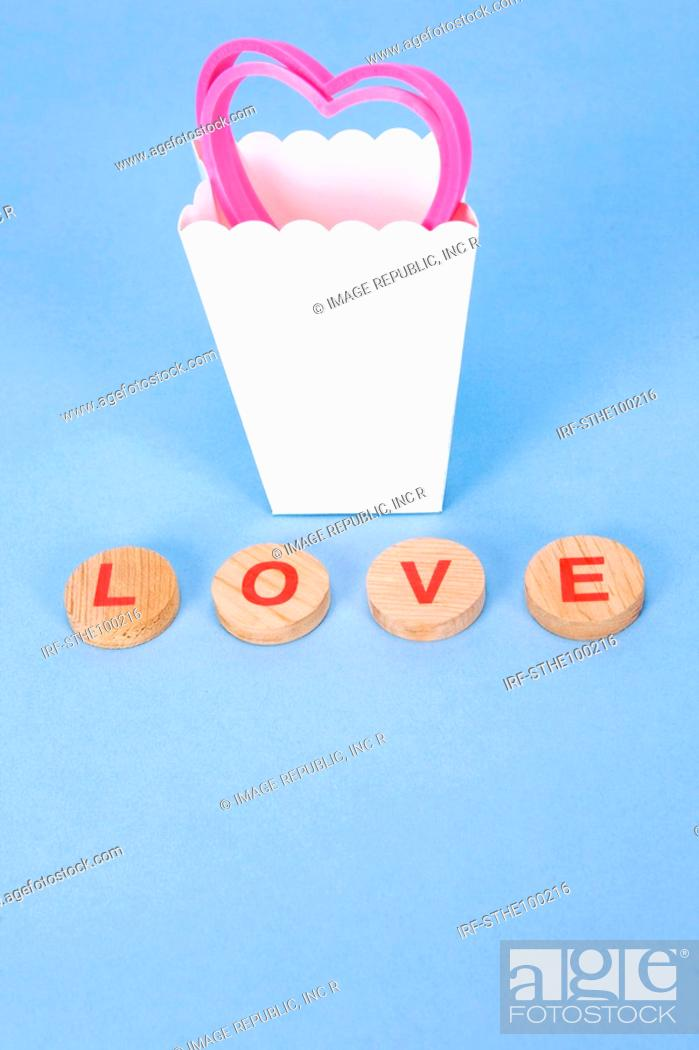 Stock Photo: heart shape in the paper bag and LOVE.