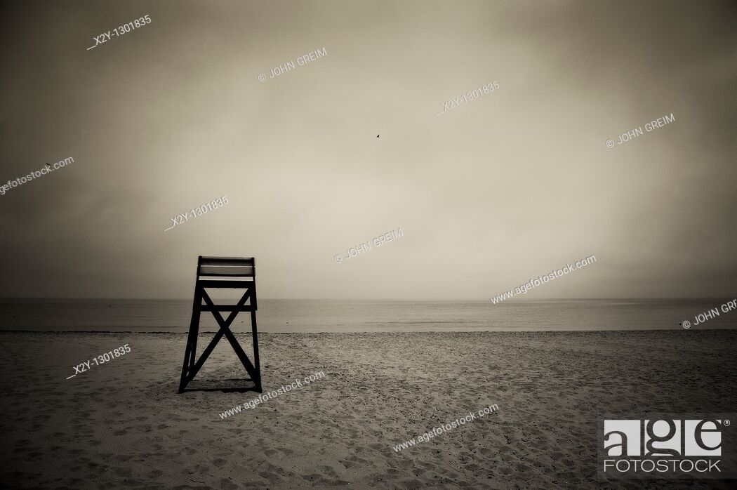 Stock Photo: Moody lifeguard stand on beach, Cape Cod, MA.