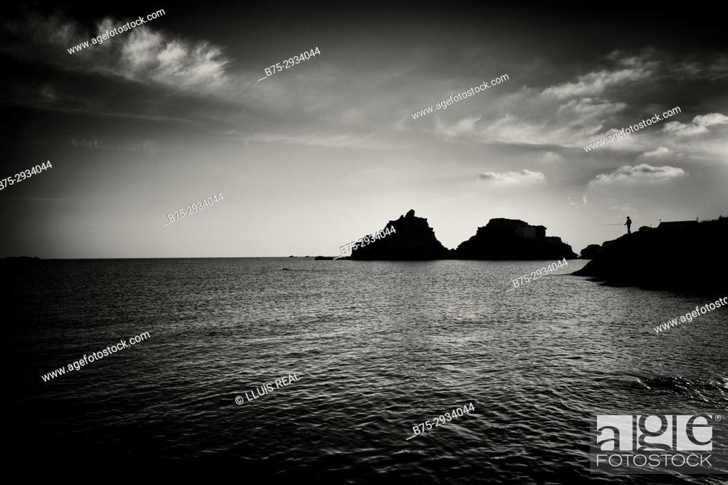Stock Photo: Silhouette of fisherman. Sa Mesquida beach, Minorca, Balearic Islands, Spain.