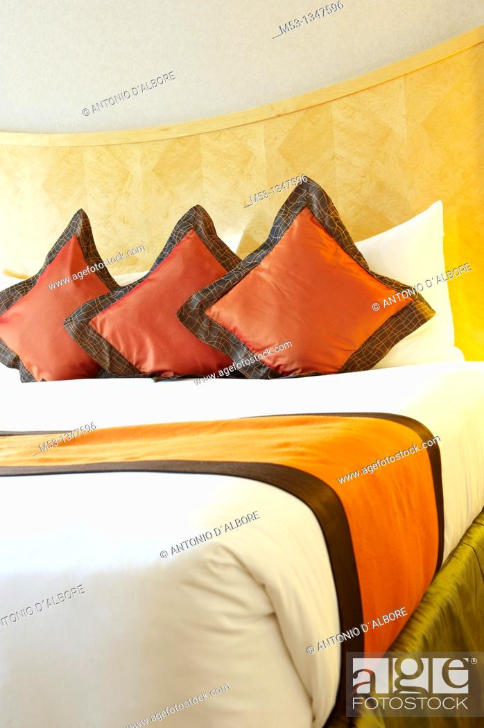 Stock Photo: elegant bed setting with silk pillows  Selective focus on the pillows.