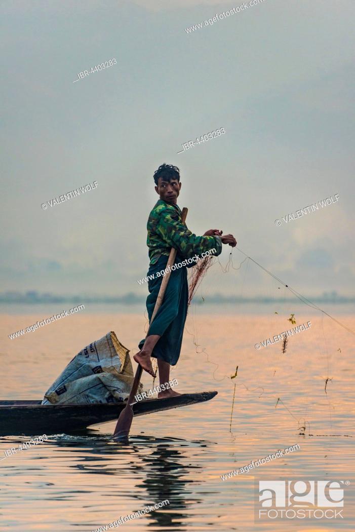 Stock Photo: Local fishermea leg rower with wooden boat, Dawn, Inle Lake, Inle Lake, Shan State, Myanmar.