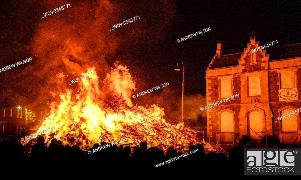 Stock Photo: A large local crowd at the hogmanay bonfire, lit on 31st December each year to celebrate the new year in the Scottish town of Biggar.